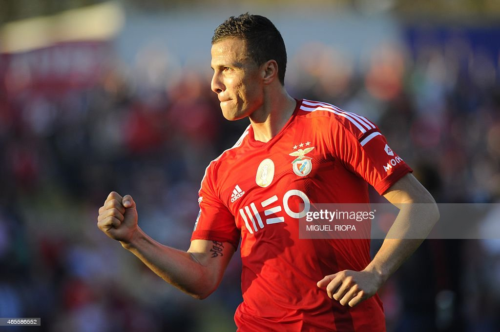 Benfica's Brazilian forward Rodrigo <a gi-track='captionPersonalityLinkClicked' href=/galleries/search?phrase=Lima+-+Brazilian+Soccer+Player&family=editorial&specificpeople=9680210 ng-click='$event.stopPropagation()'>Lima</a> celebrates after scoring a goal during the Portuguese league football match FC Arouca v SL Benfica at Arouca city stadium in Arouca on March 8, 2015.