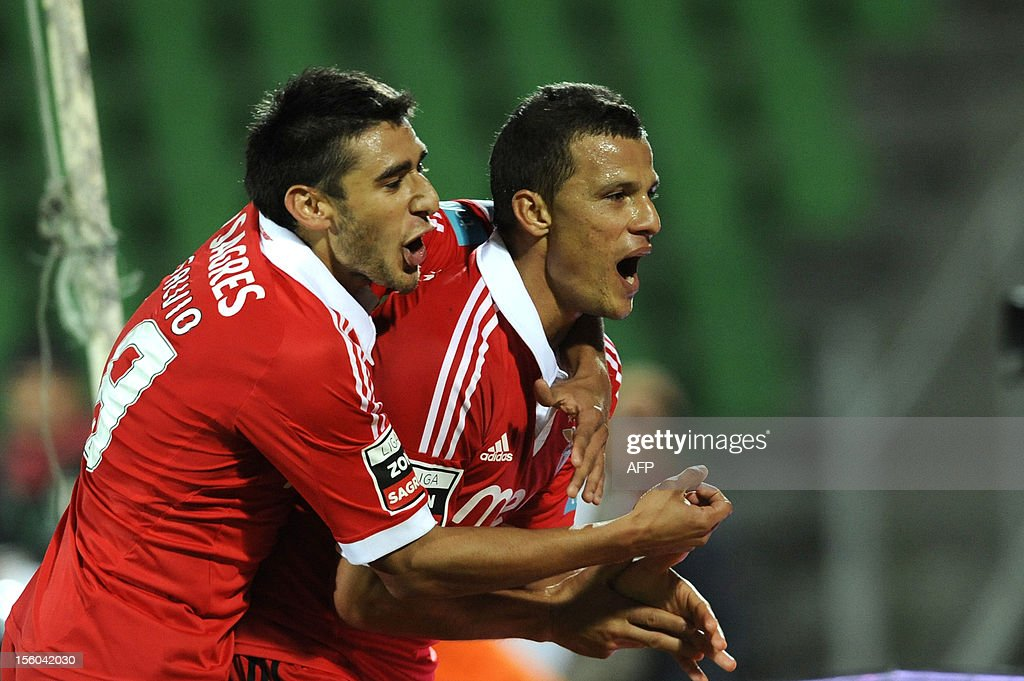 Benfica's Brazilian forward Rodrigo Lima (R) celebrates with his teammate Argentinian midfielder Eduardo Salvio after scoring during the Portuguese League football match Rio Ave vs Benfica at the Rio Ave stadium in Vila do Conde on November 11, 2012. AFP PHOTO / FERNANDO VELUDO