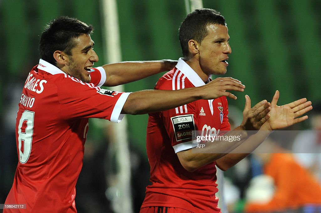 Benfica's Brazilian forward Rodrigo Lima (R) celebrates with his teammate Argentinian midfielder Eduardo Salvio after scoring during the Portuguese League football match Rio Ave vs Benfica at the Rio Ave stadium in Vila do Conde on November 11, 2012.