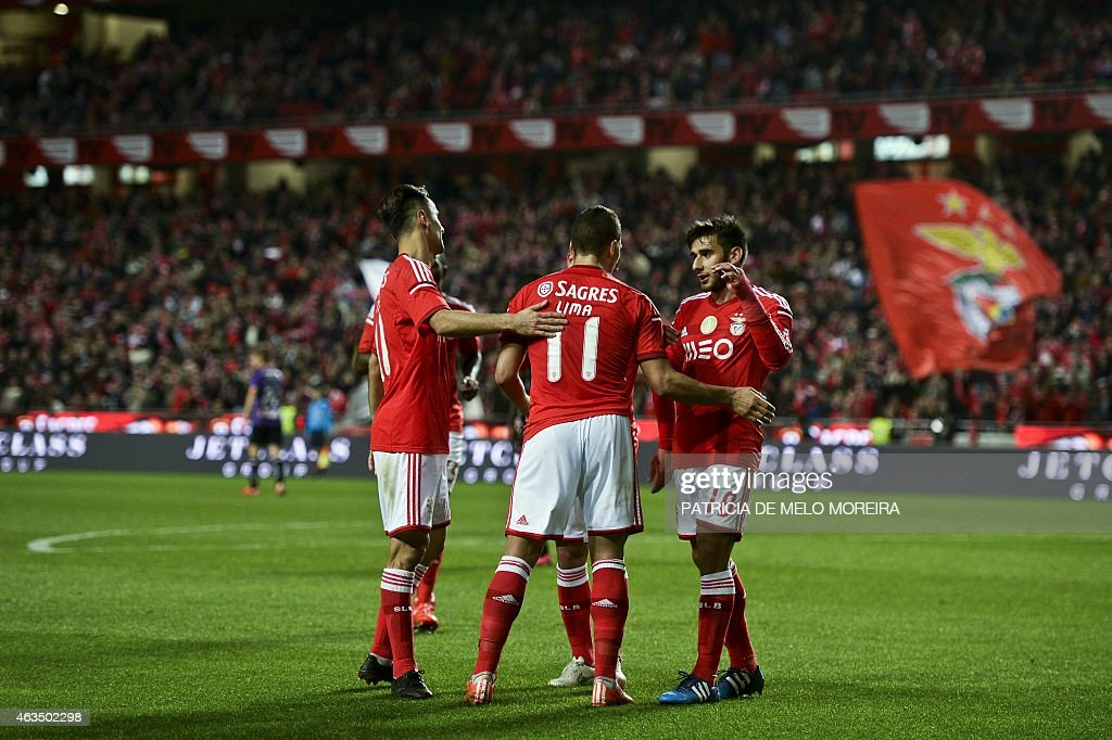 Benfica's Brazilian forward Rodrigo <a gi-track='captionPersonalityLinkClicked' href=/galleries/search?phrase=Lima+-+Brazilian+Soccer+Player&family=editorial&specificpeople=9680210 ng-click='$event.stopPropagation()'>Lima</a> (C) celebrates with his teammates after scoring during the Portuguese league football match SL Benfica vs Vitoria de Setubal at Luz stadium on February 15, 2015.