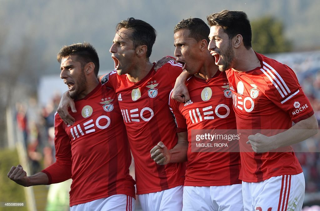 Benfica's Brazilian forward Rodrigo <a gi-track='captionPersonalityLinkClicked' href=/galleries/search?phrase=Lima+-+Brazilian+Soccer+Player&family=editorial&specificpeople=9680210 ng-click='$event.stopPropagation()'>Lima</a> (2R) celebrates with teammates Benfica's midfielder Pizzi (R), Brazilian forward <a gi-track='captionPersonalityLinkClicked' href=/galleries/search?phrase=Jonas+-+Brazilian+Forward&family=editorial&specificpeople=10555097 ng-click='$event.stopPropagation()'>Jonas</a> (2L) and Argentinian forward <a gi-track='captionPersonalityLinkClicked' href=/galleries/search?phrase=Eduardo+Salvio&family=editorial&specificpeople=5670924 ng-click='$event.stopPropagation()'>Eduardo Salvio</a> (L) after scoring a goal during the Portuguese league football match FC Arouca v SL Benfica at Arouca city stadium in Arouca on March 8, 2015.