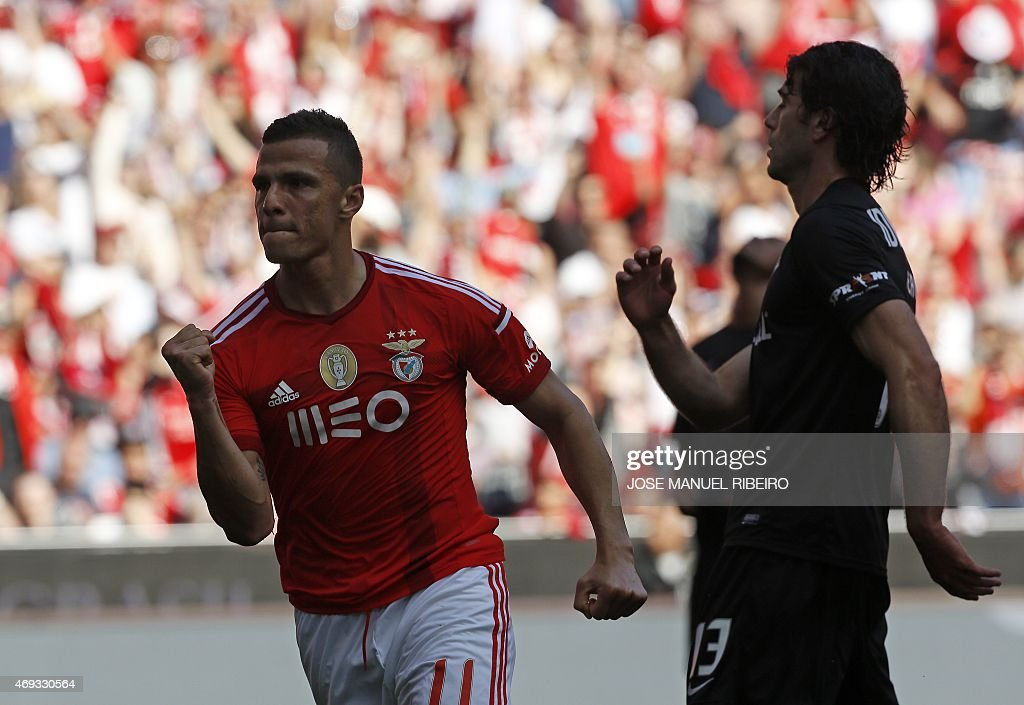 Benfica's Brazilian forward Rodrigo <a gi-track='captionPersonalityLinkClicked' href=/galleries/search?phrase=Lima+-+Brazilian+Soccer+Player&family=editorial&specificpeople=9680210 ng-click='$event.stopPropagation()'>Lima</a> dos Santos celebrates after scoring during the Portuguese league football match SL Benfica vs A Academica at the Luz stadium in Lisbon on April 11, 2015. AFP PHOTO/ JOSE MANUEL RIBEIRO