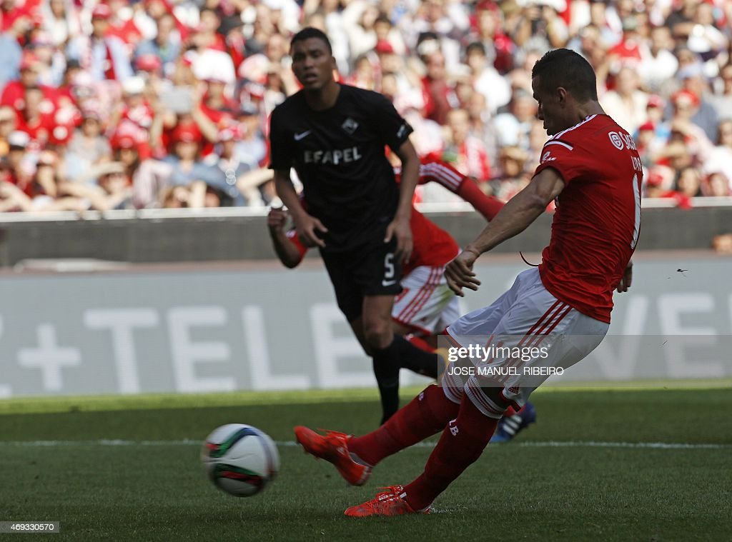 Benfica's Brazilian forward Rodrigo <a gi-track='captionPersonalityLinkClicked' href=/galleries/search?phrase=Lima+-+Brazilian+Soccer+Player&family=editorial&specificpeople=9680210 ng-click='$event.stopPropagation()'>Lima</a> dos Santos scores during the Portuguese league football match SL Benfica vs A Academica at the Luz stadium in Lisbon on April 11, 2015. AFP PHOTO/ JOSE MANUEL RIBEIRO