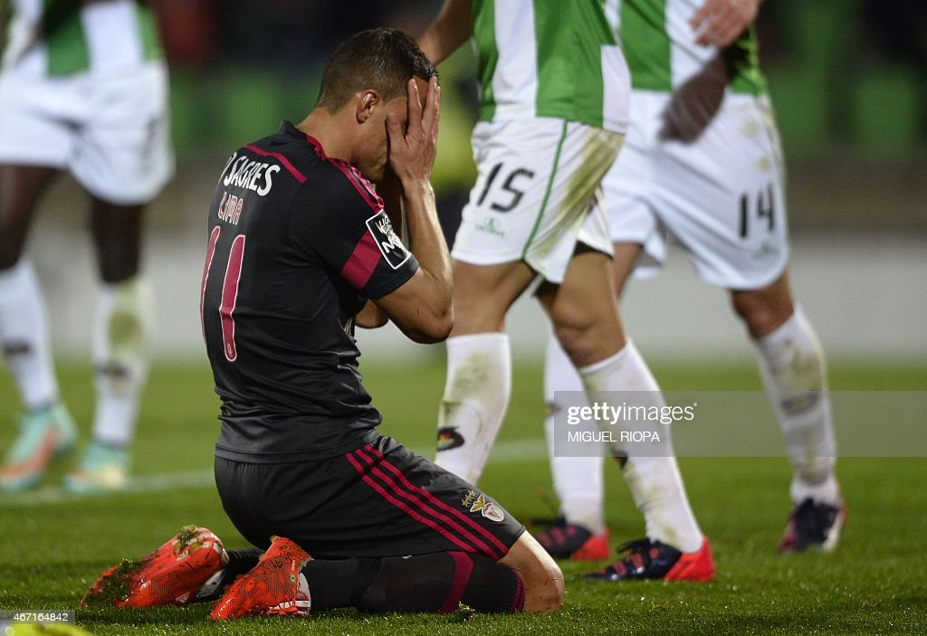Benfica's Brazilian forward Rodrigo <a gi-track='captionPersonalityLinkClicked' href=/galleries/search?phrase=Lima+-+Brazilian+Soccer+Player&family=editorial&specificpeople=9680210 ng-click='$event.stopPropagation()'>Lima</a> reacts after loosing a chance to score a goal during the Portuguese league football match Rio Ave FC v SL Benfica at the Rio Ave FC stadium in Vila do Conde on March 21, 2015. AFP PHOTO / MIGUEL RIOPA