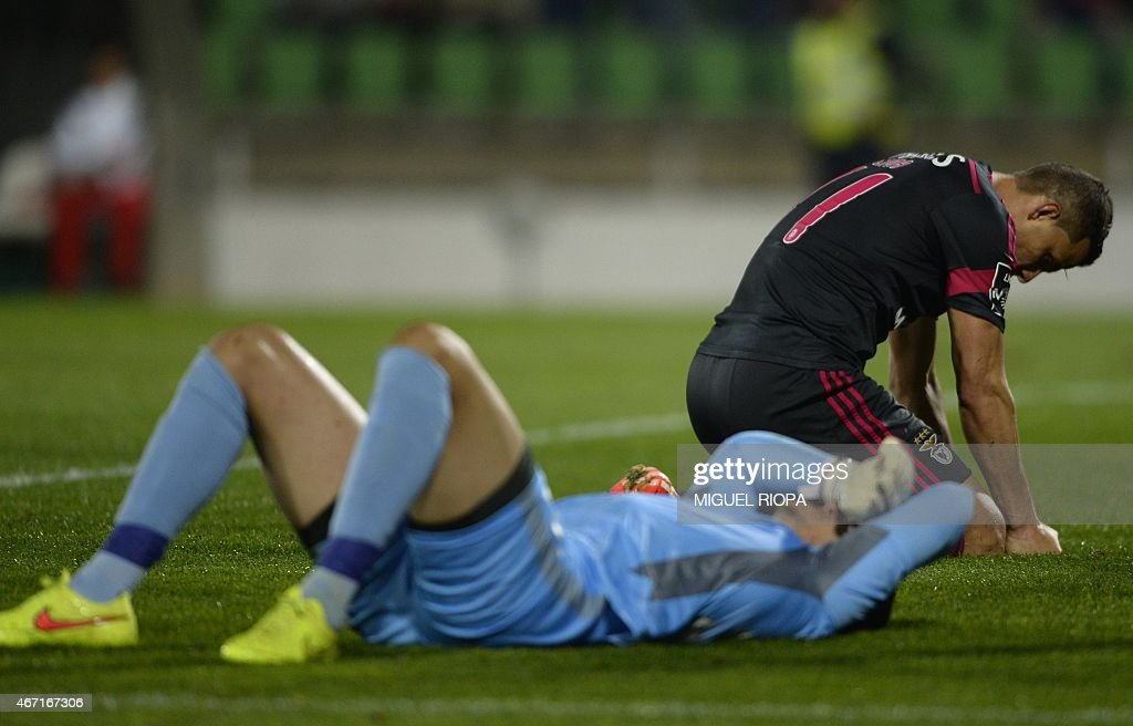 Benfica's Brazilian forward Rodrigo Lima (R) reacts after missing an attempt on goal during the Portuguese league football match Rio Ave FC v SL Benfica at the Rio Ave FC stadium in Vila do Conde on March 21, 2015. Rio Ave won the match 2-1.