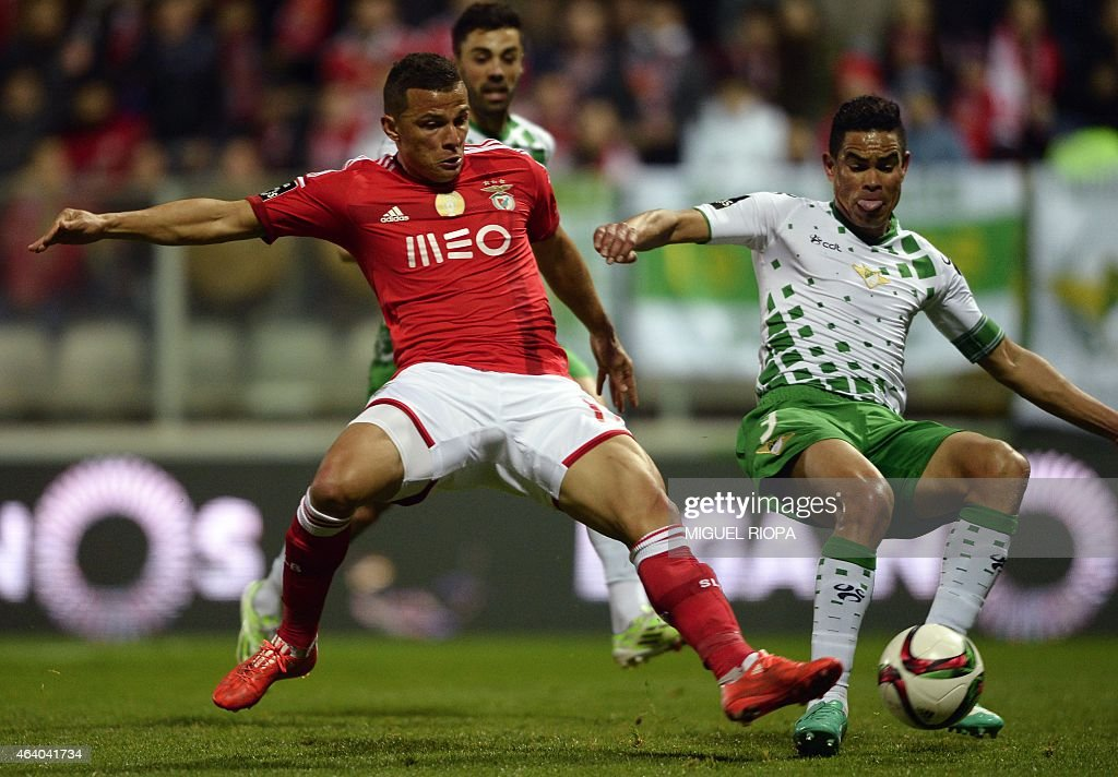 Benfica's Brazilian forward Rodrigo <a gi-track='captionPersonalityLinkClicked' href=/galleries/search?phrase=Lima+-+Brazilian+Soccer+Player&family=editorial&specificpeople=9680210 ng-click='$event.stopPropagation()'>Lima</a> (L) vies with Moreirense's Brazilian defender Anilton Junior during the Portuguese league football match Moreirense FC vs SL Benfica, at the Comendador Joaquim de Almeida Freitas stadium in Moreira de Conegos, on February 21, 2015.