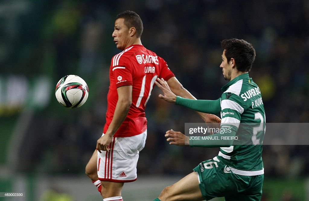 Benfica's Brazilian forward Rodrigo <a gi-track='captionPersonalityLinkClicked' href=/galleries/search?phrase=Lima+-+Brazilian+Soccer+Player&family=editorial&specificpeople=9680210 ng-click='$event.stopPropagation()'>Lima</a> (L) vies with Sportings defender Paulo Oliveira during the Portuguese Liga football match SL Benfica vs Sporting CP at Alvalade stadium in Lisbon on February 8, 2015.
