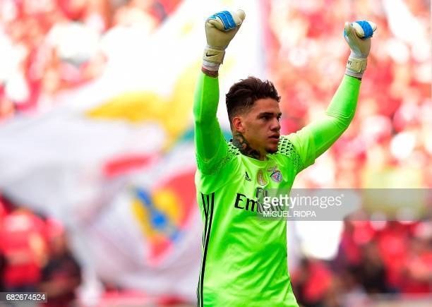 Benfica's Brazilian goalkeeper Ederson Moraes celebrates their second goal scored by teammate Mexican forward Raul Jimenez during the Portuguese...