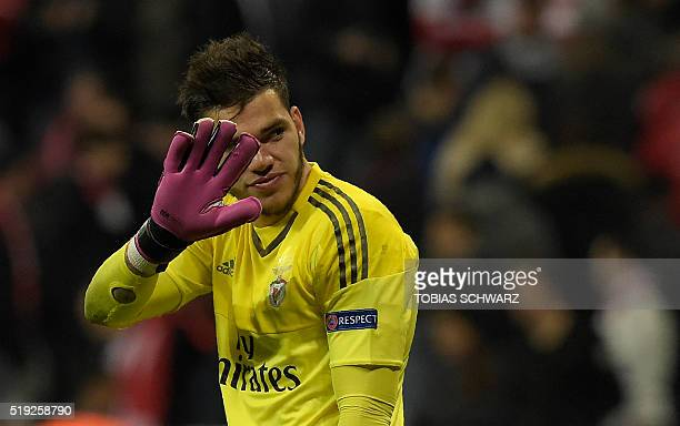 Benfica's Brazilian goalkeeper Ederson Moraes reacts after the Champions League quarterfinal firstleg football match between Bayern Munich and...