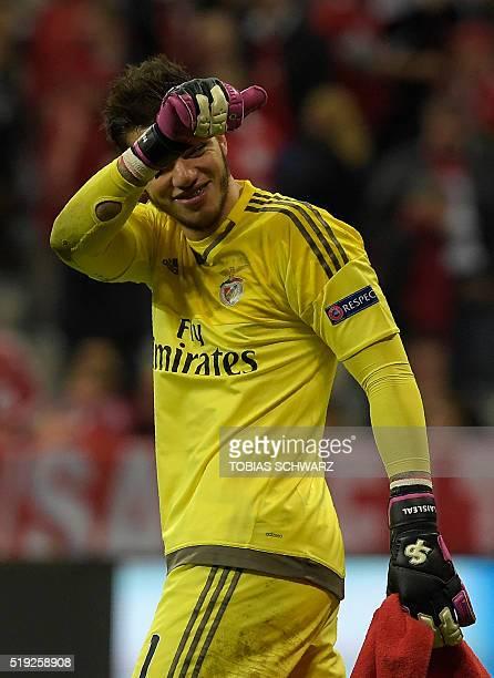 Benfica's Brazilian goalkeeper Ederson Moraes reacts after the Champions League quarterfinal firstleg football match between Bayern Munich and...
