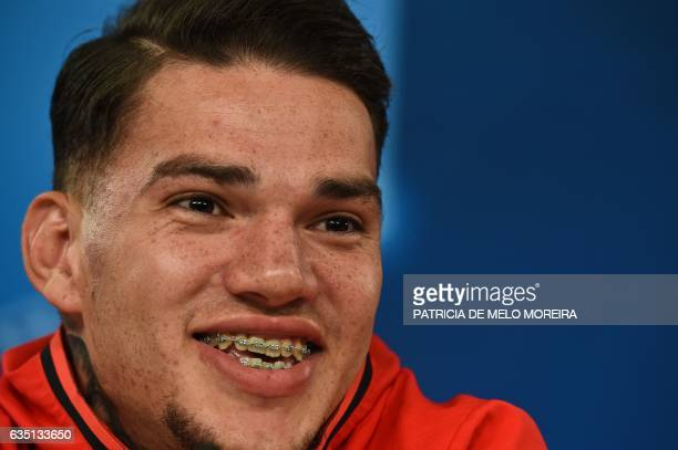 Benfica's Brazilian goalkeeper Ederson Moraes smiles during a press conference at Luz stadium in Lisbon on February 13 2017 on the eve of their UEFA...