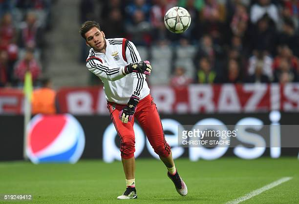 Benfica's Brazilian goalkeeper Ederson warms up prior to the Champions League quarterfinal firstleg football match between Bayern Munich and Benfica...