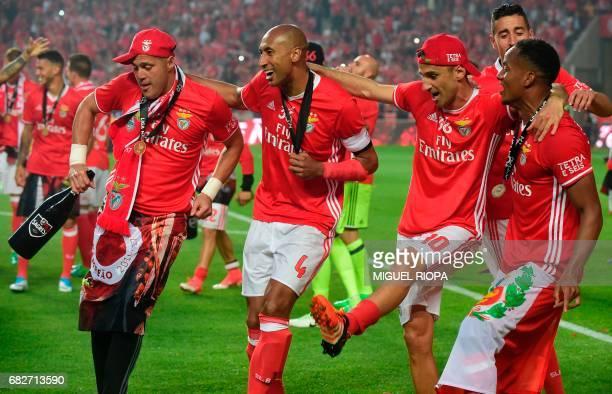 Benfica's Brazilian goalkeeper Julio Cesar Brazilian defender Luisao Brazilian forward Jonas and Peruvian forward Andre Carrillo celebrate after...