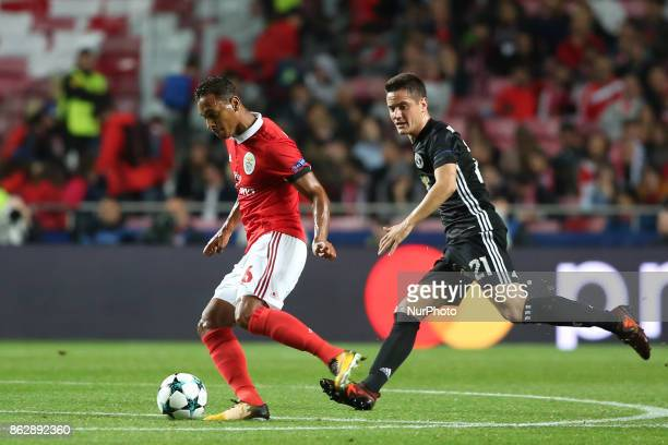 Benfica's Brazilian midfielder Filipe Augusto vies with Manchester United's Spanish midfielder Ander Herrera during the UEFA Champions League...