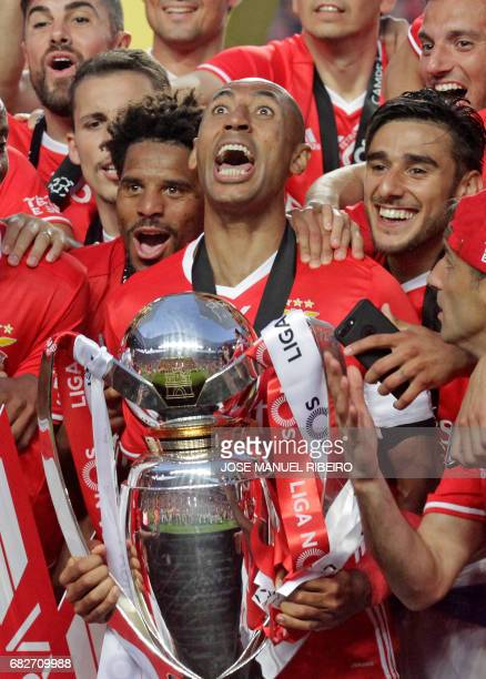 Benfica's captain Luisao and teammates celebrate their 36th title at the end of the Portuguese league football match SL Benfica vs Vitoria Guimaraes...