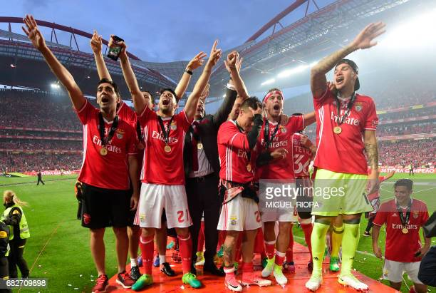 Benfica's coach Rui Vitoria celebrates with players their 36th title at the end of the Portuguese league football match SL Benfica vs Vitoria...