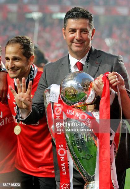 Benfica's coach Rui Vitoria holds the cup after winning their 36th title at the end of the Portuguese league football match SL Benfica vs Vitoria...