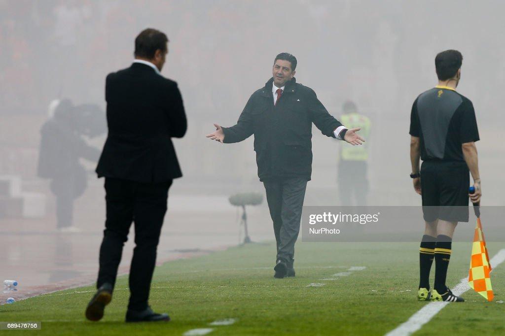 Benfica's coach Rui Vitoria (C) reacts and looks to Vitoria SC's coach Pedro Martins (L) during the Portugal Cup football final match between SL Benfica vs Vitoria SC at Jamor Stadium in Oeiras, outskirts of Lisbon on May 28, 2017.