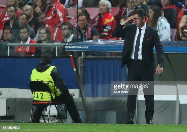 Benfica's coach Rui Vitoria reacts during the Champions League football match between SL Benfica and Manchester United at Luz Stadium in Lisbon on...