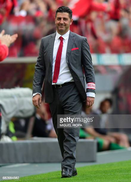 Benfica's coach Rui Vitoria smiles after his team's third goal during the Portuguese league football match SL Benfica vs Vitoria Guimaraes SC at the...