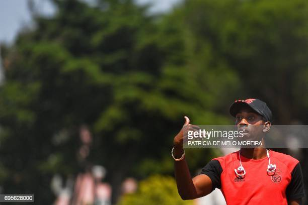 Benfica's Cuban triple jumper Pedro Pichardo gestures during a press conference to announce his return to competition at the '1st of May' stadium in...