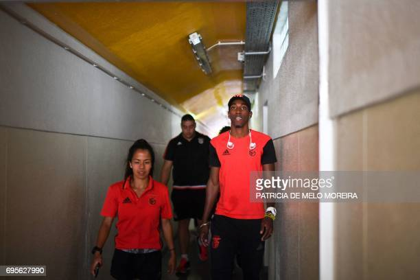 Benfica's Cuban triple jumper Pedro Pichardo walks with Benfica's 800m runner Marta Pen as he arrives to give a press conference to announce his...
