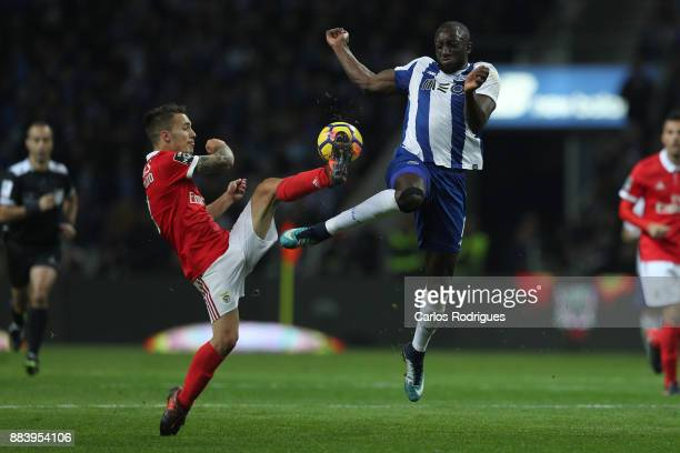 Benfica's defender Alejandro Grimaldo from Spain vies with FC PortoÕs forward Moussa Marega from Mali for the ball possession during the FC Porto v...