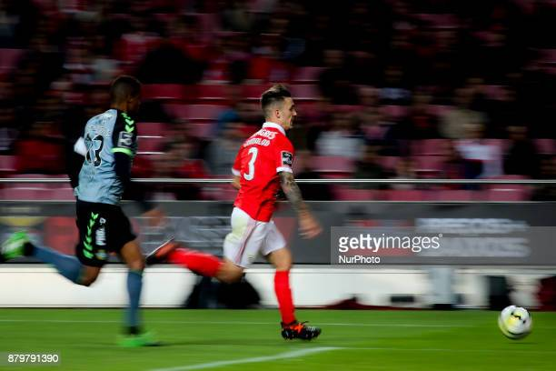 Benfica's defender Alejandro Grimaldo vies with Setubal's defender Vasco Fernandes during the Portuguese League football match between SL Benfica and...