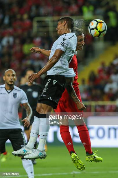 Benficas defender Alex Grimaldo and Vitoria Guimaraes forward Paolo Hurtado from Spain during the Candido Oliveira Super Cup match between SL Benfica...
