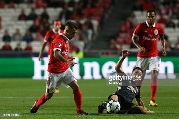 Benficas defender Alex Grimaldo from Spain and Manchester Uniteds midfielder Ander Herrera from Spain during the match between SL Benfica v...