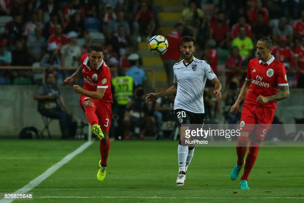 Benficas defender Alex Grimaldo from Spain Vitoria Guimaraes defender Joao Aurelio from Portugal during the Candido Oliveira Super Cup match between...