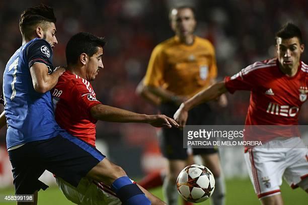 Benfica's defender Andre Almeida and Benfica's Argentine midfielder Nicolas Gaitan vies with Monaco's Belgian forward Yannick FerreiraCarrasco during...
