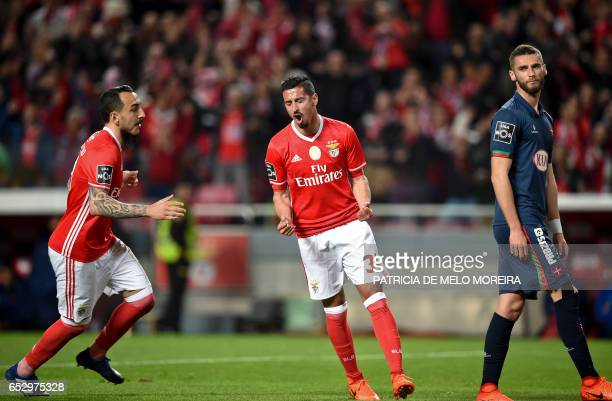 Benfica's defender Andre Almeida celebrates a goal with teammate Benfica's Greek forward Konstantinos Mitroglou during the Portuguese league football...