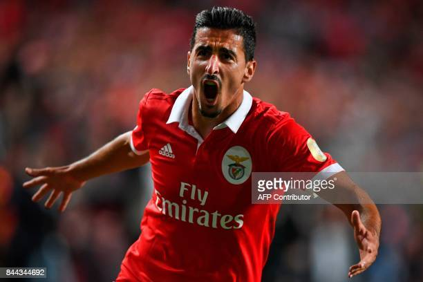 Benfica's defender Andre Almeida celebrates after scoring during the Portuguese league football match SL Benfica vs Portimonense SAD at the Luz...