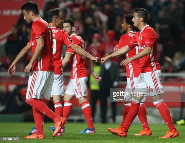 Benfica's defender Andre Almeida celebrates with teammate SL Benfica's forward from Brazil Jonas after scoring a goal during the Primeira Liga match...