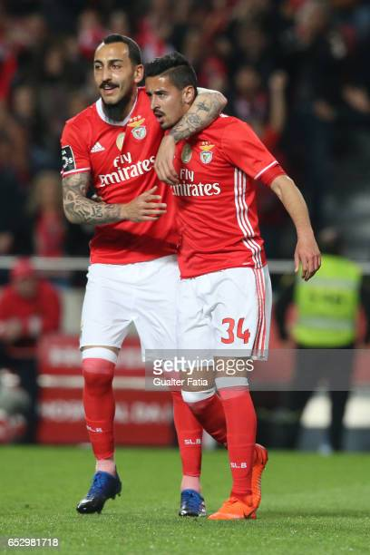 Benfica's defender Andre Almeida celebrates with teammate SL Benfica's forward from Greece Kostas Mitroglou after scoring a goal during the Primeira...