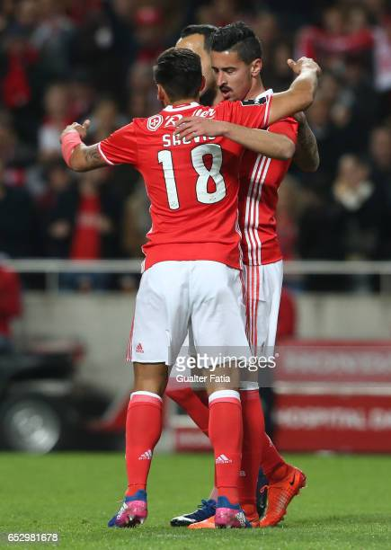 Benfica's defender Andre Almeida celebrates with teammates after scoring a goal during the Primeira Liga match between SL Benfica and CF Os...