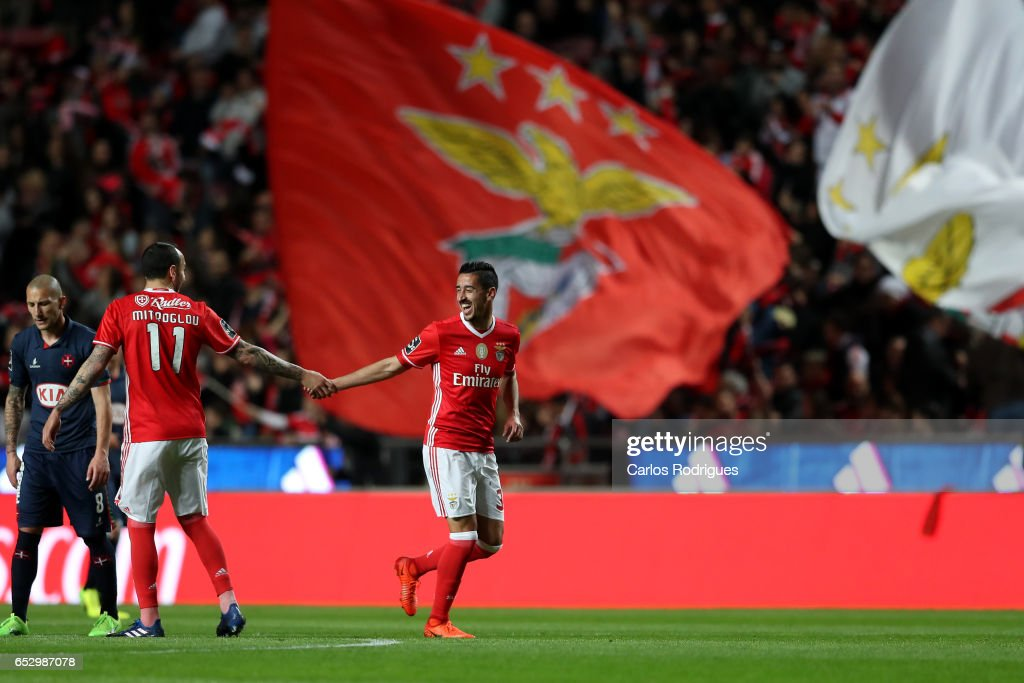 Benfica's defender Andre Almeida from Portugal celebrates scoring Benfica goal with Benfica's forward Kostas Mitroglou from Greece during the match between SL Benfica and CF Os Belenenses for the Portuguese Primeira Liga at Estadio da Luz on March 13, 2017 in Lisbon, Portugal.