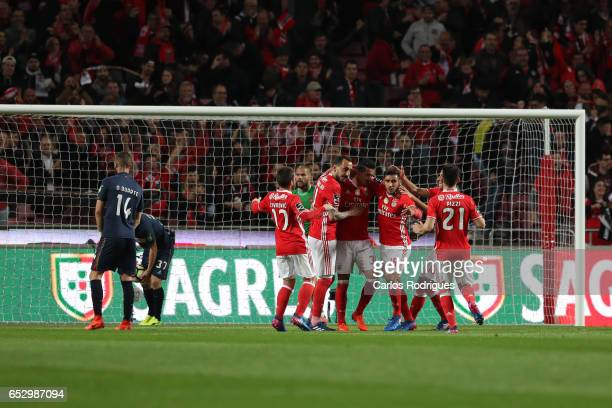 Benfica's defender Andre Almeida from Portugal celebrates scoring Benfica goal with his team mates during the match between SL Benfica and CF Os...