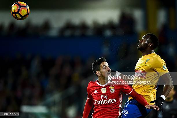 TOPSHOT Benfica's defender Andre Almeida heads the ball with Estoril's Senegalese defender Oumar Diakhite during the Portuguese league football match...