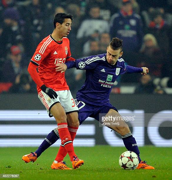 Benfica's defender Andre Almeida vies with Anderlecht's Massimo Bruno during an UEFA Champions League football match between Anderlecht and Benfica...