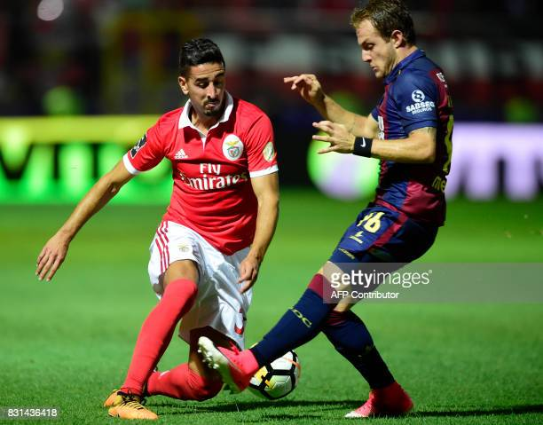 Benfica's defender Andre Almeida vies with Chaves' Brazilian defender Rafael Furlan during the Portuguese league football match between GD Chaves and...