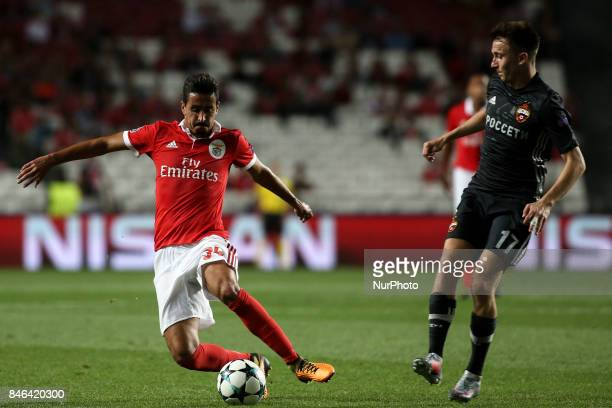 Benfica's defender Andre Almeida vies with CSKA's midfielder Aleksandr Golovin during the Champions League football match between SL Benfica and CSKA...