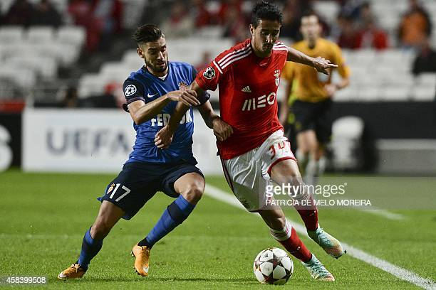 Benfica's defender Andre Almeida vies with Monaco's Belgian forward Yannick FerreiraCarrasco during the UEFA Champions League group C football match...