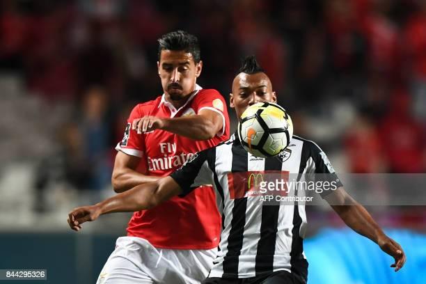 Benfica's defender Andre Almeida vies with Portimonense's Brazilian midfielder Fabricio Messias during the Portuguese league football match SL...