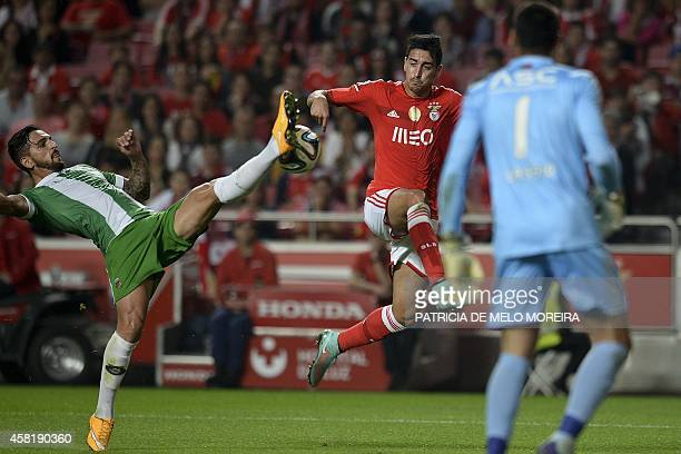 Benfica's defender Andre Almeida vies with Rio Ave's defender Nuno Lopes during the Portuguese league football match Benfica vs Rio Ave at the Luz...