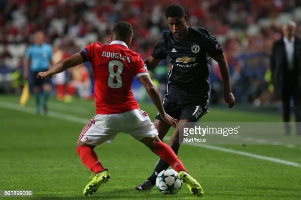 Benficas defender Douglas from Brazil and Manchester Uniteds forward Marcus Rashford from England during the match between SL Benfica v Manchester...