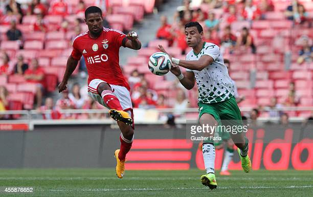 Benfica's defender Eliseu and Moreirense FC's forward Alex in action during the Portuguese First League match SL Benfica v Moreirense FC at Estadio...