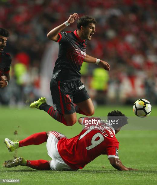 Benfica's defender Eliseu from Portugal tackles Braga forward Bruno Xadas from Portugal during the match between SL Benfica and SC Braga for the...