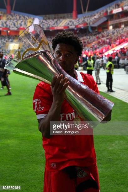 Benfica's defender Eliseu from Portugal with the Portuguese Super Cup trophy after the match between SL Benfica and VSC Guimaraes at Estadio...